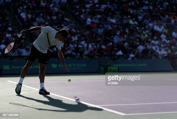 Roger Federer of Switzerland serves against Thanasi Kokkinakis of Australia during Day 6 of the Miami Open at the Crandon Park Tennis Center on March...