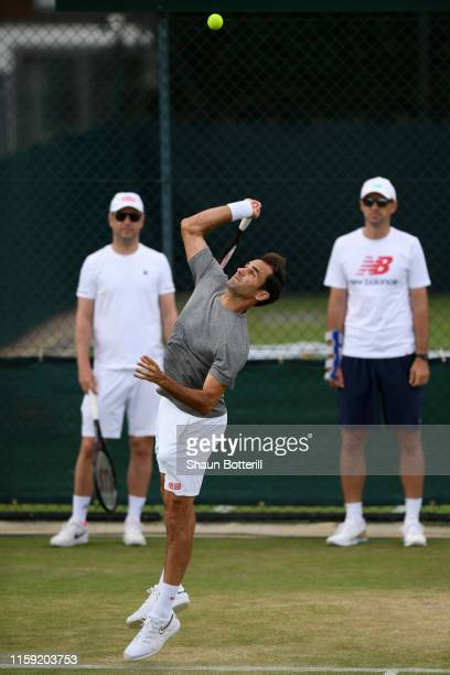 Roger Federer of Switzerland serves during a practice session ahead of The Championships - Wimbledon 2019 at All England Lawn Tennis and Croquet Club...