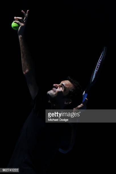 Roger Federer of Switzerland serves during a practice session ahead of the 2018 Australian Open at Melbourne Park on January 9 2018 in Melbourne...