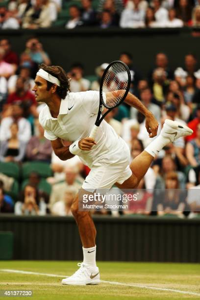 Roger Federer of Switzerland serves during his Gentlemen's Singles third round match against Santiago Giraldo of Colombia on day six of the Wimbledon...