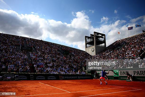 Roger Federer of Switzerland serves during his Men's quarter final match against Stanislas Wawrinka of Switzerland on day of the 2015 French Open at...