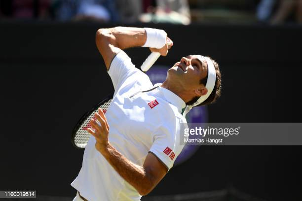 Roger Federer of Switzerland serves during his Men's Second round match against Jay Clarke of Great Britain during Day four of The Championships -...