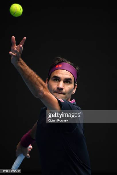 Roger Federer of Switzerland serves during his Men's Singles first round match against Steve Johnson of the United States of America on day one of...