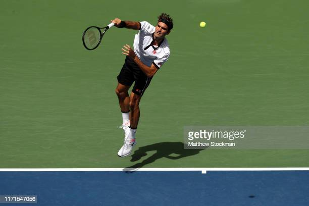 Roger Federer of Switzerland serves during his Men's Singles fourth round match against David Goffin of Belgium on day seven of the 2019 US Open at...