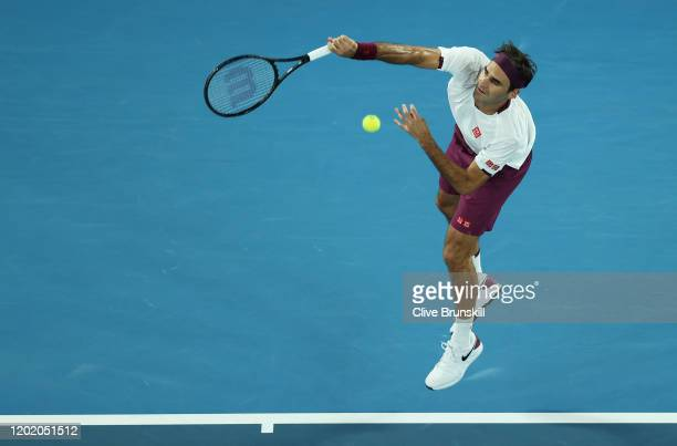 Roger Federer of Switzerland serves during his Men's Singles fourth round match against Marton Fucsovics of Hungary on day seven of the 2020...