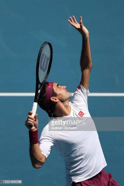 Roger Federer of Switzerland serves during his Men's Singles Quarterfinal match against Tennys Sandgren of the United States on day nine of the 2020...