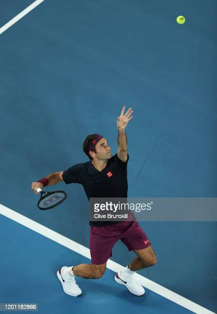 Roger Federer of Switzerland serves during his Men's Singles second round match against Filip Krajinovic of Serbia on day three of the 2020...
