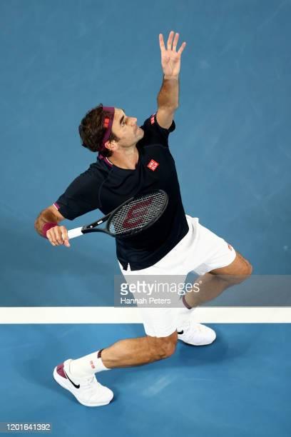 Roger Federer of Switzerland serves during his Men's Singles third round match against John Millman of Australia on day five of the 2020 Australian...