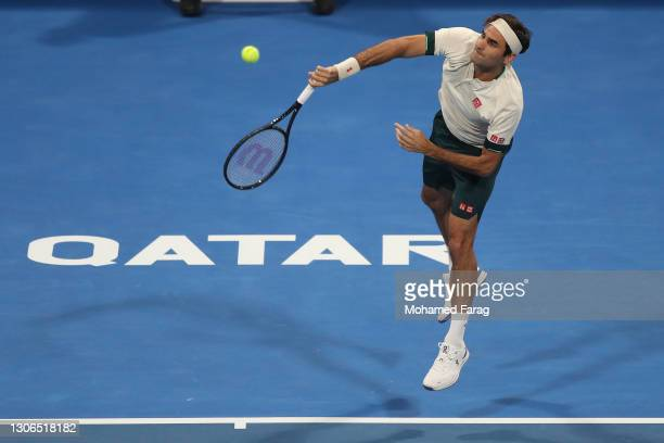 Roger Federer of Switzerland serves during his quarter final match with Nikoloz Basilashvili of Georgia in the Qatar ExxonMobil Open at Khalifa...
