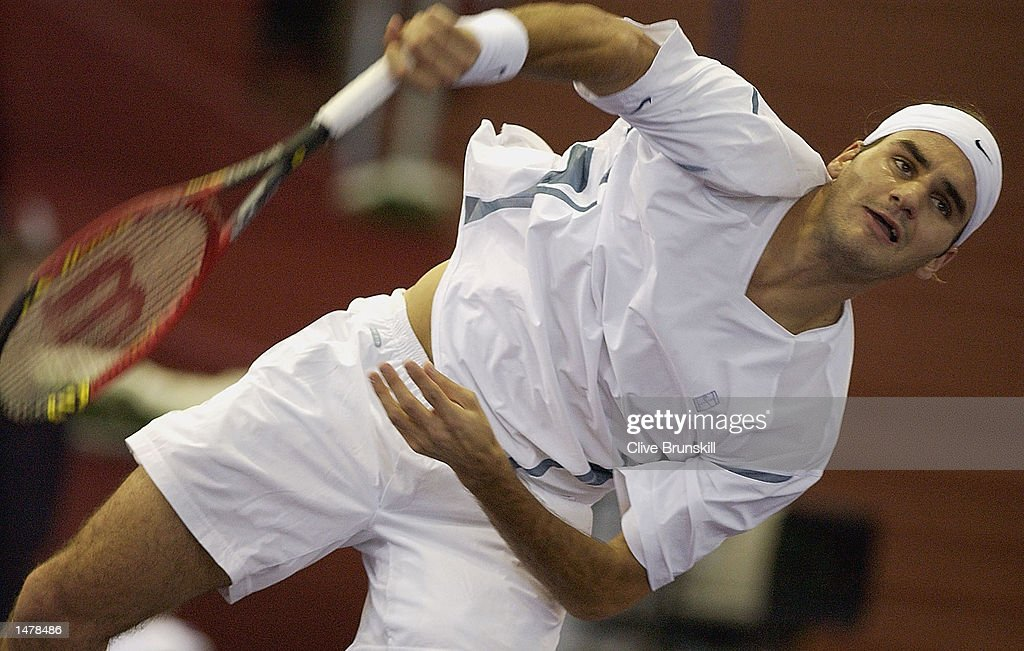 Roger Federer of Switzerland serves during his second round straight sets victory over Marcelo Rios of Chile during the Tennis Masters Madrid at The Pabellon De Cristal, Madrid, Spain on October 16, 2002.