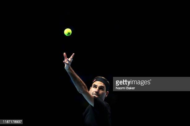 Roger Federer of Switzerland serves during his singles match against Matteo Berrettini of Italy during Day Three of the Nitto ATP Finals at The O2...
