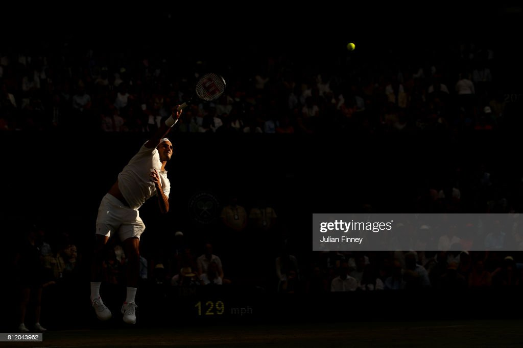 Roger Federer of Switzerland serves during the Gentlemen's Singles fourth round match against Grigor Dimitrov of Bulgaria on day seven of the Wimbledon Lawn Tennis Championships at the All England Lawn Tennis and Croquet Club on July 10, 2017 in London, England.