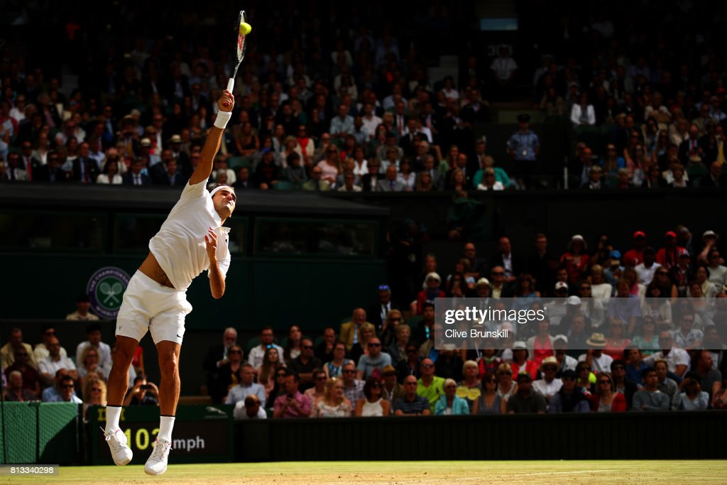 Roger Federer of Switzerland serves during the Gentlemen's Singles quarter final match against Milos Raonic of Canada on day nine of the Wimbledon Lawn Tennis Championships at the All England Lawn Tennis and Croquet Club on July 12, 2017 in London, England.