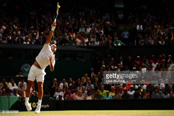 Roger Federer of Switzerland serves during the Gentlemen's Singles quarter final match against Milos Raonic of Canada on day nine of the Wimbledon...