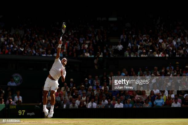 Roger Federer of Switzerland serves during the Gentlemen's Singles semi final match against Tomas Berdych of The Czech Republic on day eleven of the...