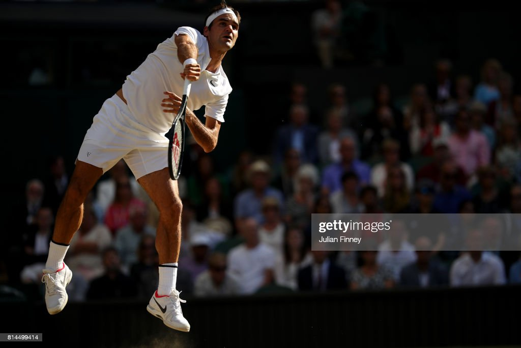 Roger Federer of Switzerland serves during the Gentlemen's Singles semi final match against Tomas Berdych of The Czech Republic on day eleven of the Wimbledon Lawn Tennis Championships at the All England Lawn Tennis and Croquet Club at Wimbledon at Wimbledon on July 14, 2017 in London, England.