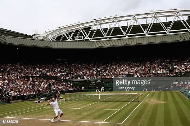 Roger Federer of Switzerland serves during the men's singles Final match against Rafael Nadal of Spain on day thirteen of the Wimbledon Lawn Tennis...