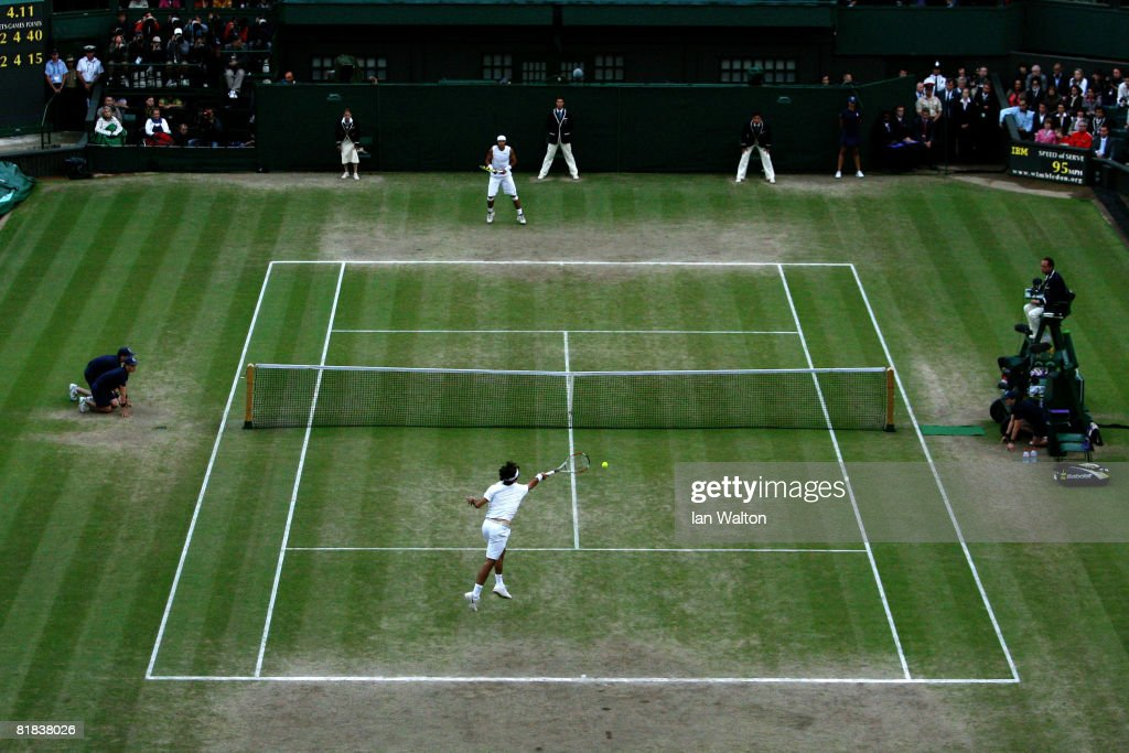 Roger Federer of Switzerland serves during the Men's Singles Final match against Rafael Nadal of Spain on day thirteen of the Wimbledon Lawn Tennis Championships at the All England Lawn Tennis and Croquet Club on July 6, 2008 in London, England.