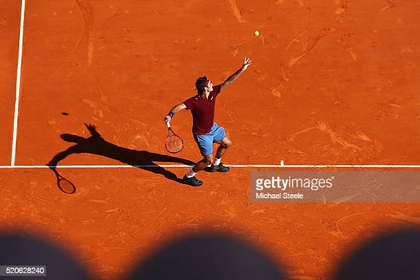 Roger Federer of Switzerland serves during the second round match against Guillermo GarciaLopez of Spain on day three of the Monte Carlo Rolex...