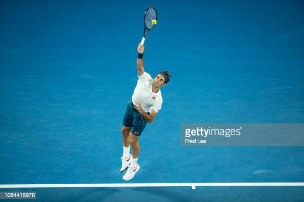 Roger Federer of Switzerland serves his third round match against Taylor Fritz of the United States during day five of the 2019 Australian Open at...