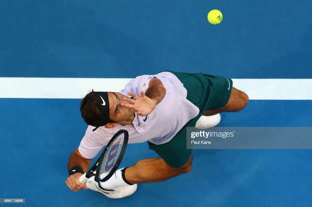 Roger Federer of Switzerland serves in his 2018 Hopman Cup match against Yuichi Sugita of Japan at Perth Arena on December 30, 2017 in Perth, Australia.