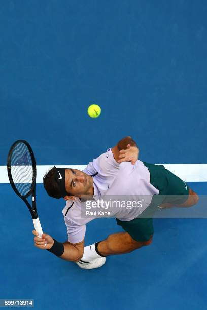 Roger Federer of Switzerland serves in his 2018 Hopman Cup match against Yuichi Sugita of Japan at Perth Arena on December 30 2017 in Perth Australia