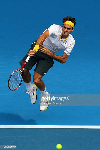 Roger Federer of Switzerland serves in his first round match against Lukas Lacko of Slovakia during day one of the 2011 Australian Open at Melbourne...