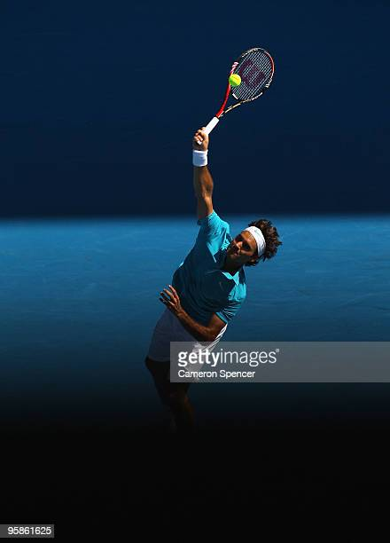 Roger Federer of Switzerland serves in his first round match against Igor Andreev of Russia during day two of the 2010 Australian Open at Melbourne...