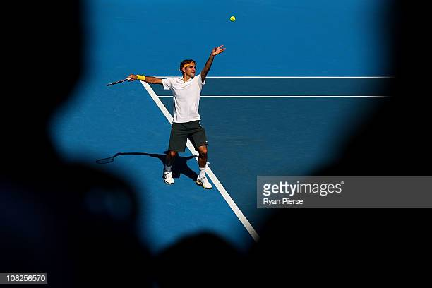 Roger Federer of Switzerland serves in his fourth round match against Tommy Robredo of Spain during day seven of the 2011 Australian Open at...