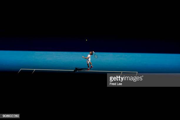 Roger Federer of Switzerland serves in his fourth round match against Marton Fucsovics of Hungary on day eight of the 2018 Australian Open at...