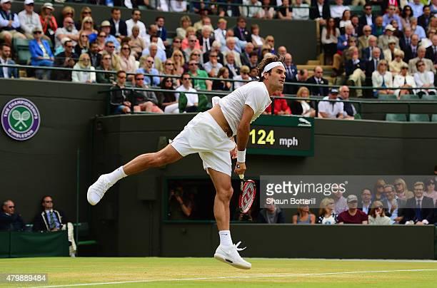 Roger Federer of Switzerland serves in his Gentlemens Singles Quarter Final match against Gilles Simon of France during day nine of the Wimbledon...