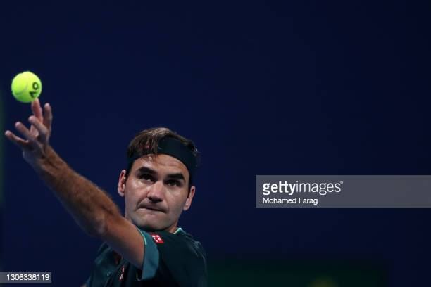 Roger Federer of Switzerland serves in his match against Dan Evans of Great Britain on Day 3 of the Qatar ExxonMobil Open at Khalifa International...