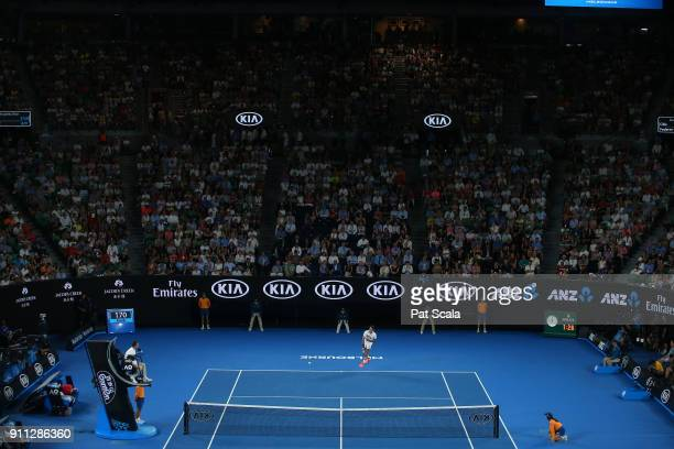 Roger Federer of Switzerland serves in his men's singles final match against Marin Cilic of Croatia on day 14 of the 2018 Australian Open at...
