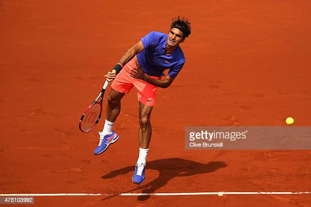 Roger Federer of Switzerland serves in his Men's Singles match against Damir Dzumhur of Bosnia and Herzegovina on day six of the 2015 French Open at...