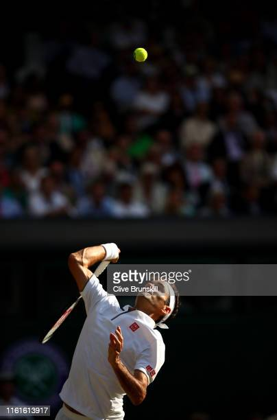 Roger Federer of Switzerland serves in his Men's Singles semi-final match against Rafael Nadal of Spain during Day eleven of The Championships -...