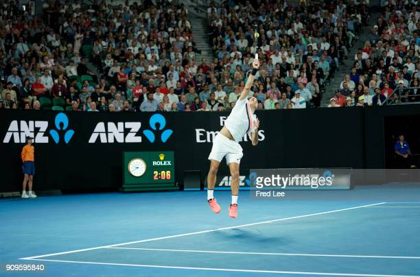 Roger Federer of Switzerland serves in his quarterfinal match against Tomas Berdych of the Czech Republic on day 10 of the 2018 Australian Open at...