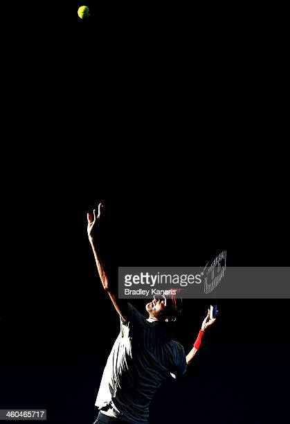 Roger Federer of Switzerland serves in his semi final match against Jeremy Chardy of France during day seven of the 2014 Brisbane International at...
