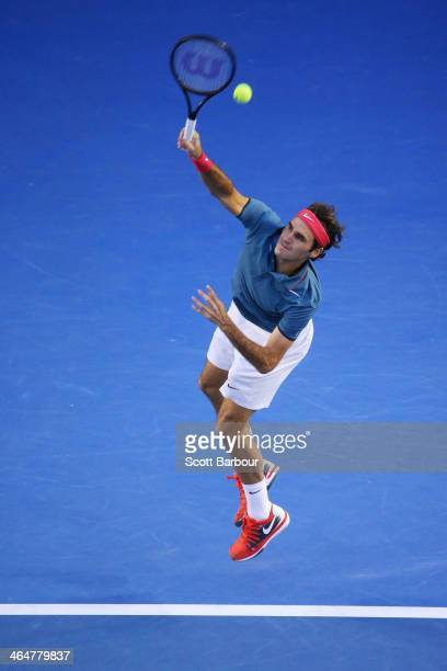 Roger Federer of Switzerland serves in his semifinal match against Rafael Nadal of Spain during day 12 of the 2014 Australian Open at Melbourne Park...