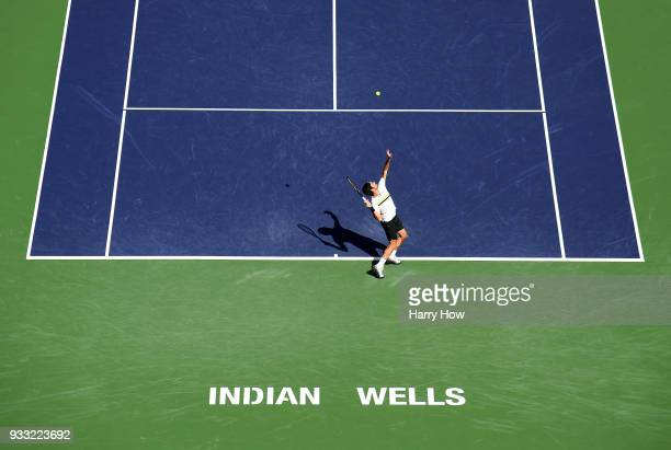 Roger Federer of Switzerland serves in his semifinal win over Borna Coric of Croatia during the BNP Paribas Open at the Indian Wells Tennis Garden on...