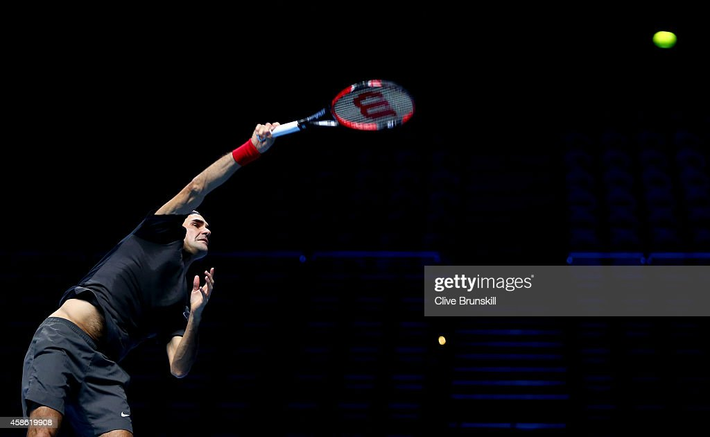 Roger Federer of Switzerland serves in practice during the Barclays ATP World Tour Finals tennis previews at the O2 Arena on November 8, 2014 in London, England.