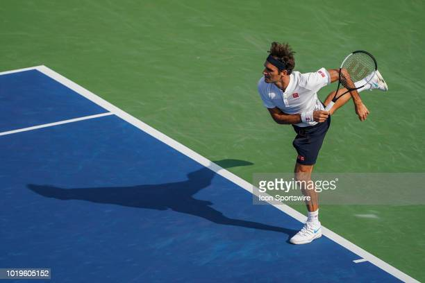 Roger Federer of Switzerland serves in the championship match with Novak Djokovic of Serbia during the Western Southern Open singles final at the...