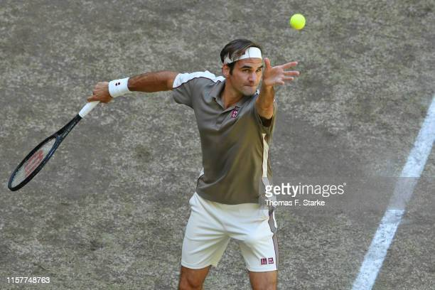 Roger Federer of Switzerland serves in the final match against David Goffin of Belgium during day 7 of the Noventi Open at Gerry Weber Stadium on...