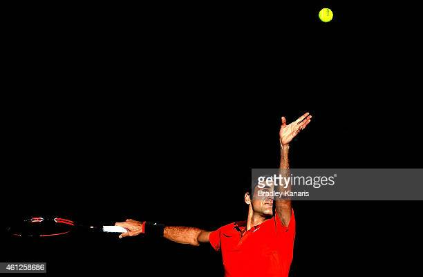 Roger Federer of Switzerland serves in the Men's semi final match against Grigor Dimitrov of Bulgaria during day seven of the 2015 Brisbane...