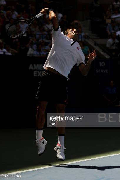 Roger Federer of Switzerland serves the ball during his Men's Singles third round match against Daniel Evans of Great Britain on day five of the 2019...