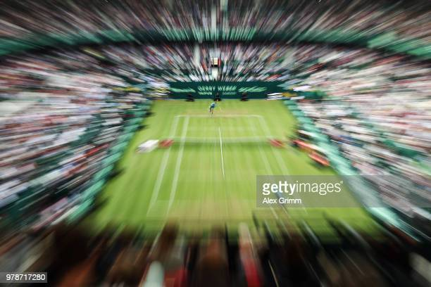 Roger Federer of Switzerland serves the ball to Aljaz Bedene of Slovenia during their first round match on day 2 of the Gerry Weber Open at Gerry...