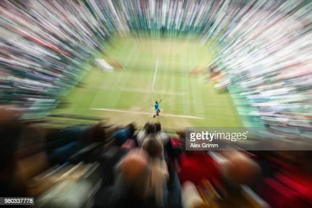 Roger Federer of Switzerland serves the ball to Benoit Paire of France during their round of 16 match on day 4 of the Gerry Weber Open at Gerry Weber...