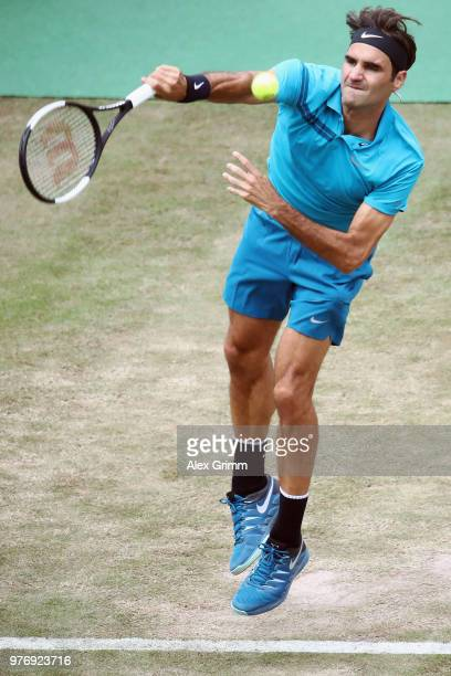 Roger Federer of Switzerland serves the ball to Milos Raonic of Canada during the final match on day 7 of the Mercedes Cup at Tennisclub Weissenhof...
