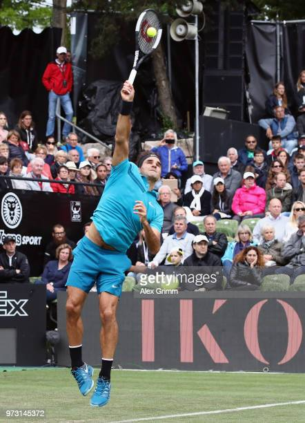 Roger Federer of Switzerland serves the ball to Mischa Zverev of Germany during day 3 of the Mercedes Cup at Tennisclub Weissenhof on June 13 2018 in...