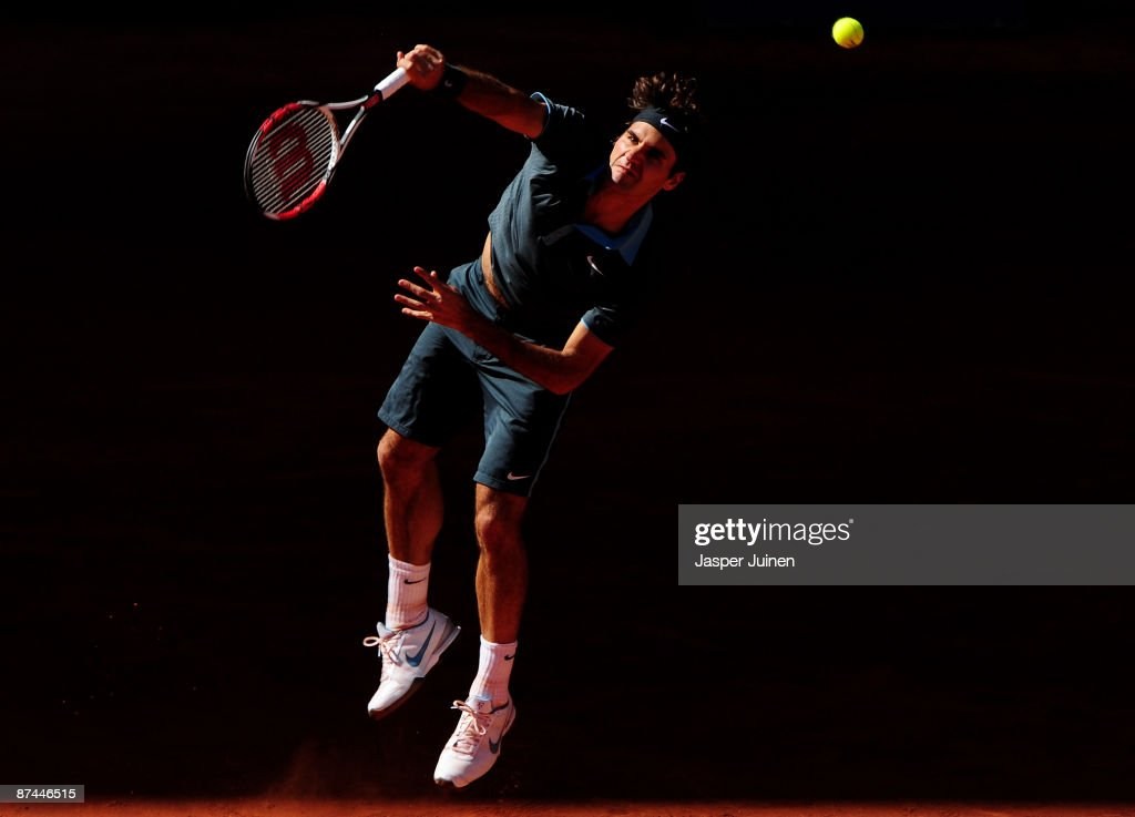 Roger Federer of Switzerland serves the ball to Rafael Nadal of Spain during the final of the Madrid Open tennis tournament at the Caja Magica on May 17, 2009 in Madrid, Spain. Federer won the match in two sets, 6-4 and 6-4.
