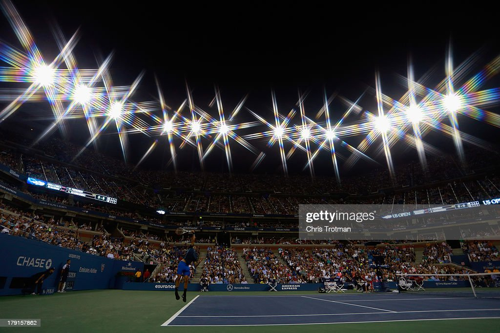 Roger Federer of Switzerland serves to Adrian Mannarino of France in the second set during the round match on Day Six of the 2013 US Open at the USTA Billie Jean King National Tennis Center on August 31, 2013 in New York City.
